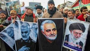 Shia Muslims carry photographs of the killed Iranian military commander Qasem Soleimani as they take part in a protest against the US Air strike on Iraq military base.(PTI Photo)