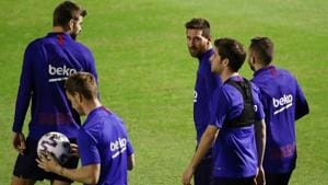 Barcelona's Lionel Messi with teammates during training.(REUTERS)