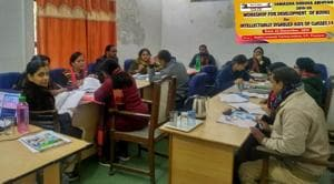 Experts busy in a workshop convened to develop books for intellectually disabled kids at ELTI-Prayagraj(HT file)