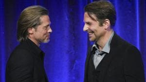 Actor Brad Pitt, left, accepts the best supporting actor award for Once Upon A Time… in Hollywood, from actor Bradley Cooper at the National Board of Review Awards gala.(Evan Agostini/Invision/AP)