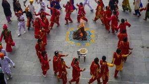 Jammu: Students in traditional attire dance around a bonfire as they celebrate Lohri festival in Jammu, Saturday, Jan. 11, 2020.(PTI)