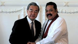 Chinese Foreign Minister Wang Yi shakes hands with Sri Lankan Prime Minister Mahinda Rajapaksa.(Reuters image)