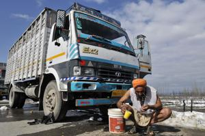 A stranded truck driver wash his face as he stranded at Srinagar-Jammu national highway.(HT FILE PHOTO)