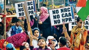 People at a protest against the CAA, NRC and NPR, in Kolkata on Sunday.(ANI)