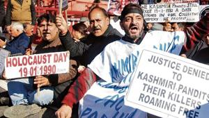Kashmiri Pandit migrants shout slogans against Jammu and Kashmir government during a protest in Jammu, on Sunday, January 19, 2020. Large sections of the 400,000-strong Pandit community were forced to leave Kashmir in January 1990 following terror attacks and a secessionist movement spearheaded by extremist groups.(Nitin Kanotra / HT Photo)