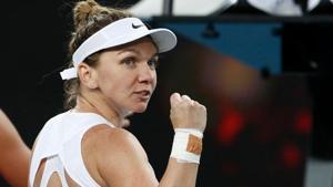 Romania's Simona Halep reacts during the match against Jennifer Brady.(REUTERS)