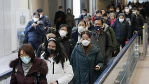 Passengers arriving from the Chinese city of Wuhan arrive at Narita Airport in Chiba, Japan.(REUTERS)