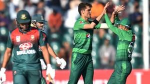 Pakistan's Shaheen Afridi (2R) celebrates with captain Babar Azam (R) after taking a wicket.(AFP)