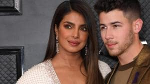 Priyanka Chopra poses with US singer-songwriter and husband Nick Jonas at the 62nd Annual Grammy Awards on January 26.(AFP)