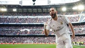 Real Madrid's Karim Benzema celebrates scoring their first goal.(REUTERS)