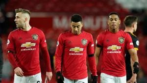 Manchester United's Luke Shaw, Jesse Lingard and Mason Greenwood look dejected after the match.(REUTERS)