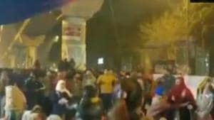 Many people, including students, have started gathered outside the Jamia Nagar police station late on Sunday night.(ANI PHOTO.)