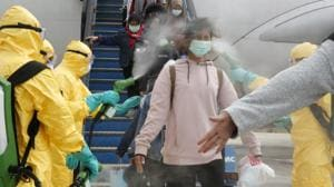 Medical officers spray Indonesian nationals with antiseptic after they arrived from Wuhan, China center of the coronavirus epidemic, before transferring them to the Natuna Islands military base to be quarantined, at Hang Nadim Airport in Batam.(REUTERS)