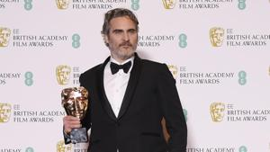 Joaquin Phoenix poses with his award for Leading Actor for Joker at the British Academy of Film and Television Awards (BAFTA) at the Royal Albert Hall in London.(REUTERS)