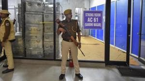 Security personnel stand guard outside the strong room on the eve of Delhi Assembly elections, at Akshardham in New Delhi, Friday, Feb. 7, 2020.(PTI photo)