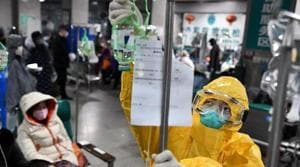 A medical worker in protective suit adjusts a drip bag for a patient at a hospital, following an outbreak of the new coronavirus in Wuhan, Hubei province, China.(Reuters Photo)