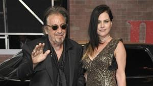 Al Pacino, left, and Meital Dohan arrive at the Los Angeles premiere of The Irishman.(Richard Shotwell/Invision/AP)