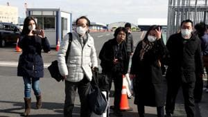 Passengers wearing face masks walkout from the cruise ship Diamond Princess at Daikoku Pier Cruise Terminal in Yokohama on Wednesday, Feb 19, 2020.(REUTERS)