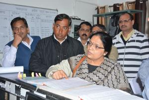 Principal safety officer Seema Kumar checking records of breathalyser tests of the running staff at the loco lobby of the Chandigarh railway station on Friday.(SANT ARORA/HT)