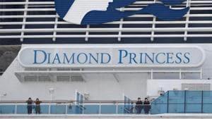 Masked passengers look on from on board the coronavirus-hit Diamond Princess cruise ship docked at Yokohama Port, south of Tokyo, Japan, on February 20, 2020.(Reuters Photo)
