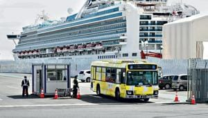With the disembarkation, a 14-day quarantine is expected to start for more than 1,000 crew still on board as many of them did not undergo quarantine because they were needed to keep the ship running.(AP Photo/Eugene Hoshiko)