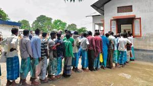 People check their names in final NRC list in Assam in 2019.(AFP)