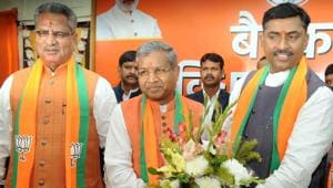 BJP National General Secretary Muralidhar Rao congratulates newly elected Leader of Opposition Babulal Marandi after a meeting at state BJP headquarters in Ranchi on Monday.(DIWAKAR PRASAD/ HT PHOTO.)