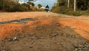 Roads in the Industrial Area of Phase 8B in Mohali are riddled with potholes.(Sushil Prajapati/HT)
