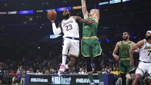 Los Angeles Lakers forward LeBron James (23) passes the ball under pressure from Boston Celtics center Daniel Theis (27) in the first half at Staples Center.(USA TODAY Sports)