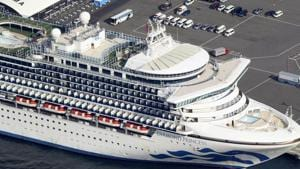 The US-operated Diamond Princess is anchored as emergency vehicles stand by at Yokohama Port, near Tokyo, Wednesday, Feb. 12, 2020.(AP)