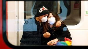 A couple wearing face masks is seen in the subway in Duomo underground station in Milan, as the country is hit by the coronavirus outbreak, Italy February 25, 2020.(REUTERS)