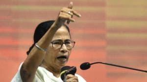 West Bengal chief minister Mamata Banerjee addressing a gathering of party workers at the Netaji Indoor Stadium in Kolkata on Monday.(SAMIR JANA/HT PHOTO.)