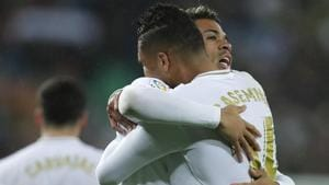Real Madrid's Mariano Diaz, center, celebrates with Casemiro after scoring their side's second goal.(AP)