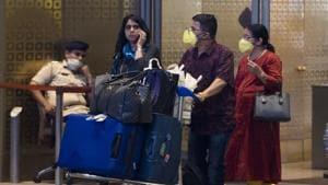 People wearing face mask as protection against coronavirus, arrive at Chhatrapati Shivaji Maharaj International Airport on Wednesday.(Satyabrata Tripathy/HT Photo)