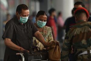 Passengers are seen wearing safety masks for prevention against coronavirus, at Netaji Subhas Chandra Bose International (NSCBI) airport, in Kolkata, India.(HT Photo/Samir Jana)