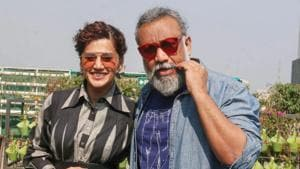 Taapsee Pannu with film director Anubhav Sinha poses for photographs.(PTI)