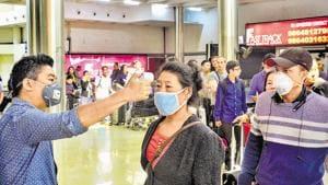 Passengers undergo a thermal screening test in the wake of coronavirus scare at Dimapur airport in Nagaland.(PTI)