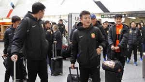 Players of the Chinese Super League team Wuhan Zall arrive at the Atocha train station in Madrid.(AP)