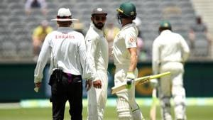 Virat Kohli of India and Tim Paine of Australia bump into each other during day four of the second match in the Test series between Australia and India at Perth Stadium on December 17, 2018 in Perth, Australia. (Photo by Cameron Spencer/Getty Images)(Getty Images)