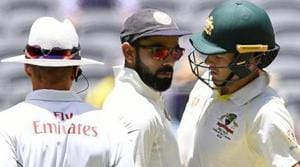 India's captain Virat Kohli (C) and Australia's captain Tim Paine react after Paine ran a single during play on day four of the second test match between Australia and India at Perth Stadium in Perth, Australia, December 17, 2018.(REUTERS)
