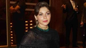 Kanika Kapoor, best known for songs such as Baby Doll and Chitiya Kaliyan in the world of Hindi entertainment, landed at the Mumbai airport on March 9.(Prodip Guha/ Hindustan Times)