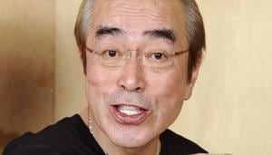 In this May 2012, photo, Japanese comedian Ken Shimura gestures with a funny face to a photographer in Tokyo.(AP)