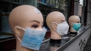 Various protective face masks, worn by many people during the coronavirus pandemic, are on display for sale outside a shop in Berlin, April 2, 2020(AFP)