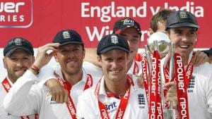 Graeme Swann and Kevin Pietersen flank England captain Andrew Strauss during trophy celebrations after England beat India 4-0 in a Test series in England in 2011.(Agencies)