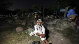 A homeless man seen after fire broke at a shelter home near Nigambodh Ghat, Kashmiri Gate on day eighteen of the 21 day nationwide lockdown to check the spread of coronavirus, in New Delhi.(Amal KS/HT PHOTO)