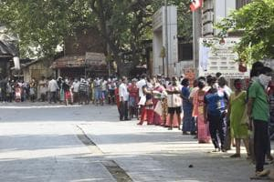 Public standing in line for Free Ration at Nahar Road,Malad during lockdown due to coronavirus pandemic.(Hindustan Times)