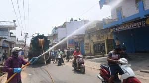 Firefighters sanitize a locality during the nationwide lockdown to curb the spread of coronavirus, in Ranchi, Saturday. April 18, 2020.(PTI)