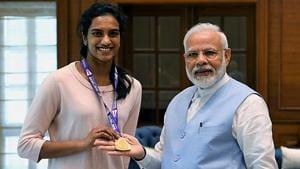 Prime Minister Narendra Modi congratulates World Badminton champion PV Sindhu during a meeting in New Delhi.(ANI Photo)