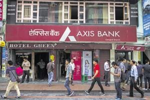 People walk past a branch of Axis Bank Ltd on Mahatma Gandhi Road in Gangtok city of Sikkim in this file photo.(Bloomberg Photo)