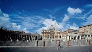 A woman walks at the Saint Peter's Square in Rome, Italy.